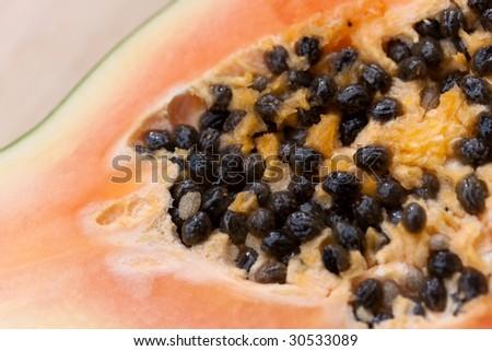 Food Related: Preparing a papaya fruit - stock photo