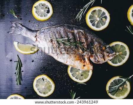 Food, restaurant. Fish on the wooden table - stock photo