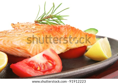 food: roast salmon on metal pan over red wooden plate isolated over white background - stock photo