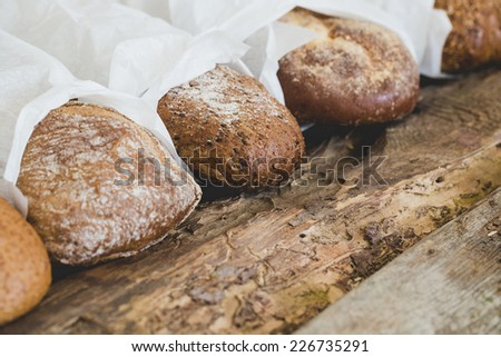 Food, rural. Yummy bread on the wooden table
