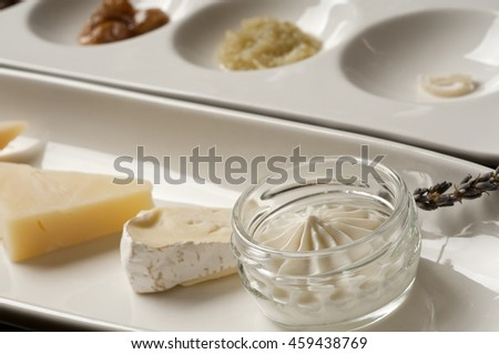 Food sampling plates, cheeses and spreads - stock photo