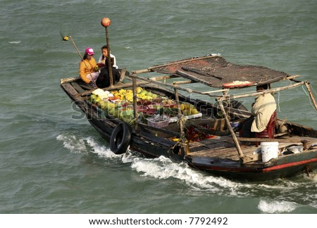 food sellers in boat, Ha Long Bay, Vietnam