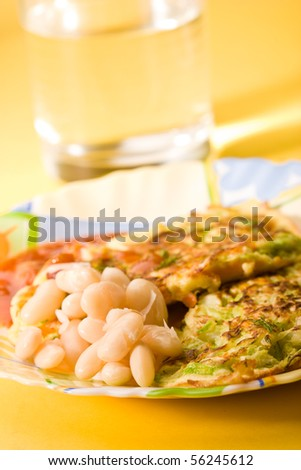 food serias: fried veggy with sour cream and kidney beans