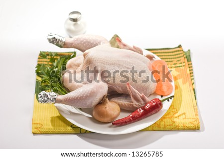 food series: raw chicken with vegetables and spicery on the plate