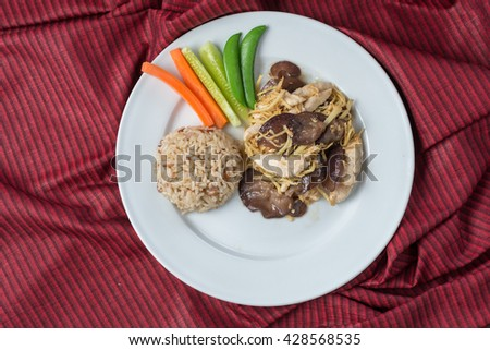Food series : Stirred fried chicken breast with ginger, served with brown rice and fresh vegetable, Thai foods