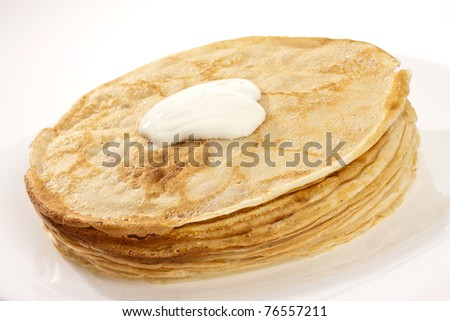 food series: tasty hot pancake with sour cream