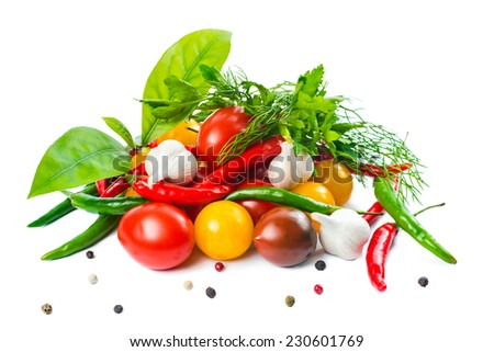 food setting with fresh ripe red, yellow, black cherry tomatoes, garlic, pepper and greens is isolated on the white background - stock photo