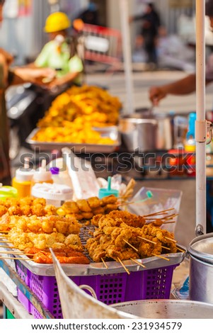 Food snacks on sale in a thai street market in Bangkok, Thailand - stock photo