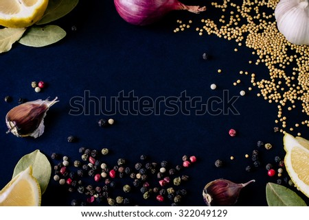 Food spice seasoning ingredients for cooking in cuisine on dark background in the wooden spoon. Dry powder curry, ginger, cardamon, chili, laurel, lemon. Asian  yellow, green colorful aroma condiment. - stock photo