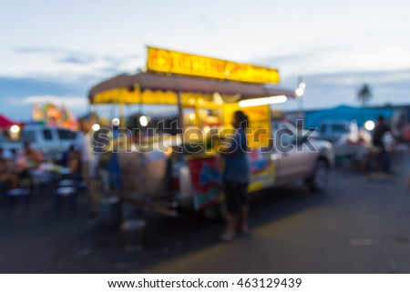 Food Stall or Mobile Pickup Food Shop in Market Fair or Local Night Market, Blur or Defocus Background