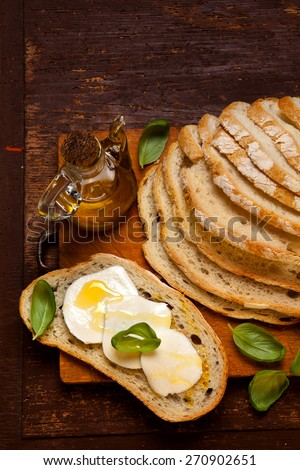 food still life. sliced fresh bread, tomato and mozzarella bruschetta with. olive oil - stock photo