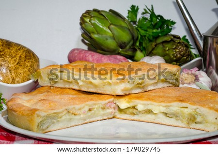 food stuffed with sausage, smoked cheese, artichokes and potatoes