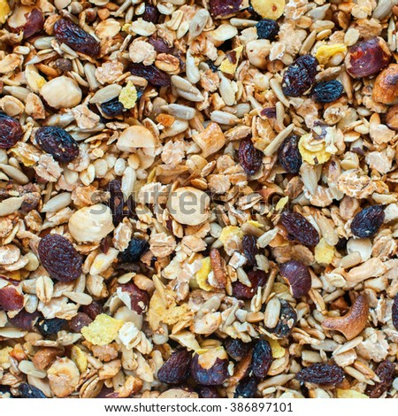 Food Texture Muesli Dry Fruits Nuts Oats Raisin Cereals Flakes Background  - stock photo