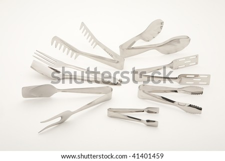 food tongs on white background