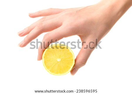 Food: women`s hand holding lemon, isolated on white background - stock photo