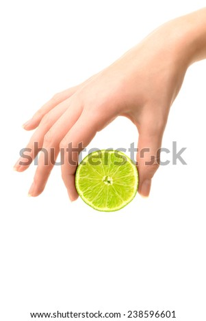 Food: women`s hand holding lime, isolated on white background - stock photo