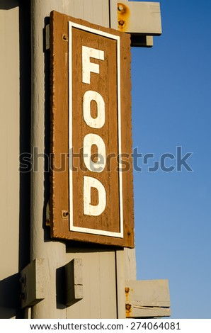Food wooden sign with a blue sky on background - stock photo