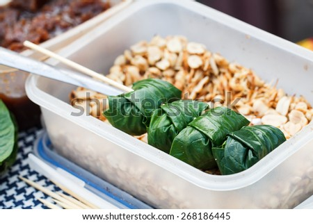 Food wrapped in leaves or Miang Kham sold as local market, Thailand-4 - stock photo