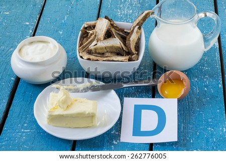Foods containing vitamin D: cream, sour cream, mushrooms, butter, egg yolk - stock photo