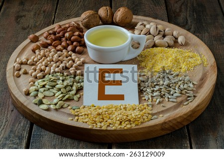 Foods containing vitamin E: oil, peas, lentils, corn, peanuts, pistachios, walnuts, sunflower seeds and pumpkin - stock photo