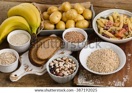Foods high in carbohydrate on a wooden background. Top view - stock photo