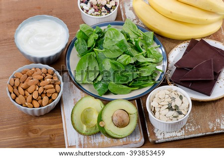 Foods High in Magnesium on a wooden table. Top view - stock photo