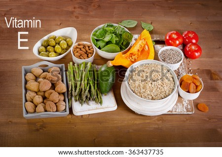 Foods high in vitamin E on a wooden table. Top view - stock photo