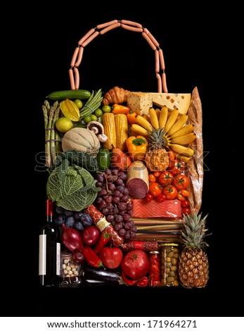 Foodstuff handbag / studio photography of designer handbag made from different fruits and vegetables - on black background  - stock photo