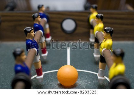 foosball game close up symmetrical - stock photo