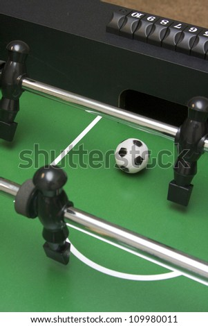Foosball shot at the opponent's goal - stock photo