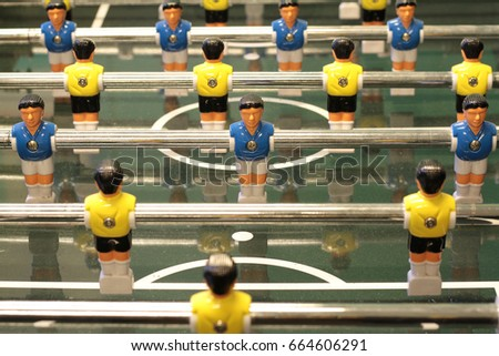 Foosball, Table football game or Table Soccer with yellow and blue players