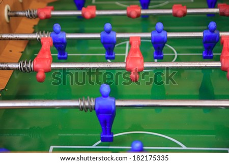 foosball table game in action - stock photo