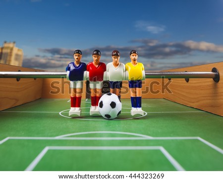 foosball table soccer .sport teame football players - stock photo