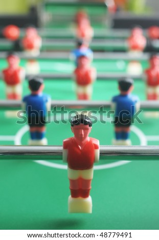 Foosball table with players