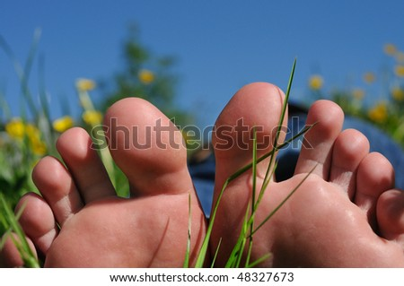 foot and toes with spring nature background - stock photo