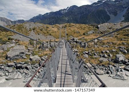 Foot Bridge in Aoraki//Mount Cook National Park, South Island, New Zealand - stock photo