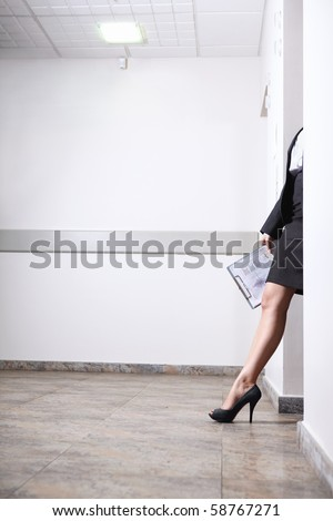Foot girl coming out of doors - stock photo