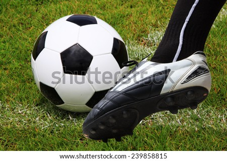 foot kicking soccer ball start game isolated  - stock photo