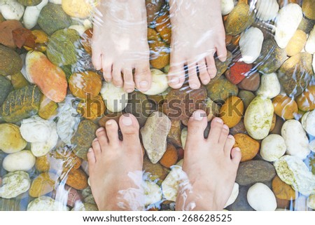 foot massage by pebble - stock photo