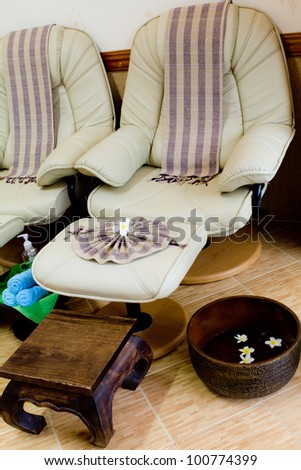 Foot massage chair in spa room