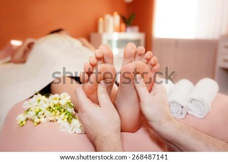 foot massage.  close-up - stock photo
