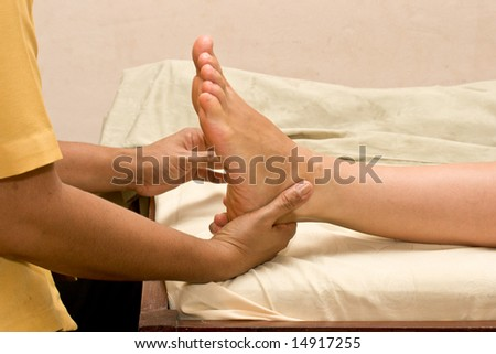 Foot massage in spa close up - stock photo