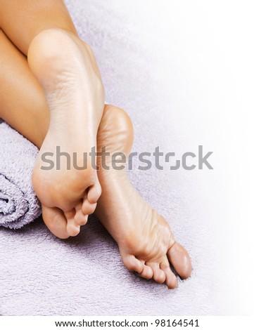 Foot massage in the spa salon - stock photo