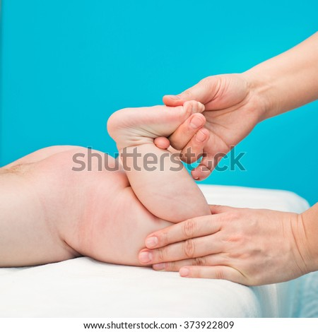 foot massage newborn - stock photo