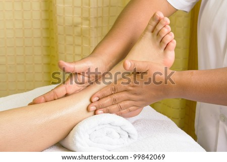foot massage, spa foot oil treatment. - stock photo