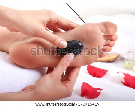 Foot massage (stone therapy) - stock photo