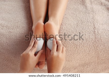 Foot massage with spa stones