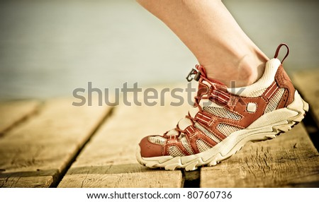 Foot of jogging person - stock photo