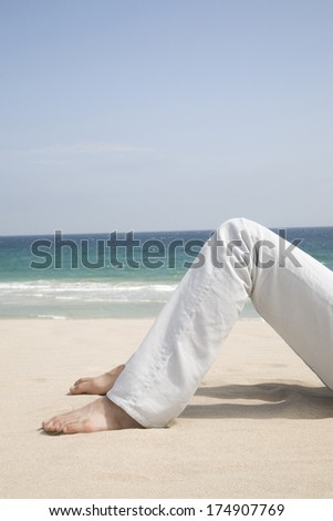 Foot of Man lying on the beach