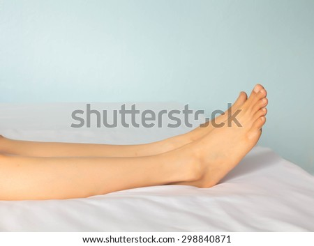 Foot of the woman on the  bed